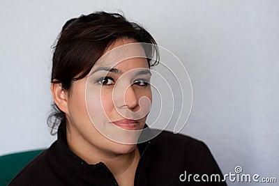 Portrait of serious or stern Hispanic woman