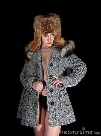 Portrait of sexual girl in gray coat and fur hat