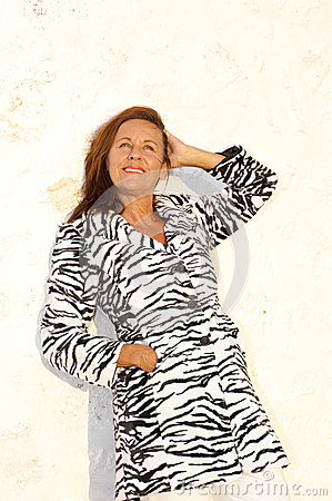 Attractive mature woman wearing zebra coat