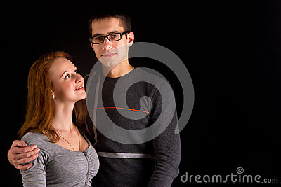 Portrait of sexy couple posing in studio