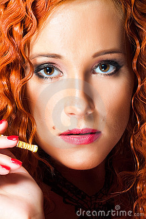 Portrait of sexy girl with red hair