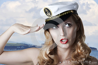 Portrait of sexy pin up model salutes