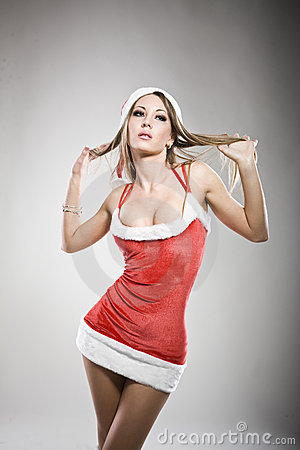 Portrait of sexy Santa girl touching her hair