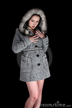 Portrait of sexy woman in gray coat