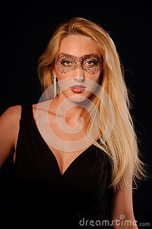 Portrait of sexy woman in make-up party mask