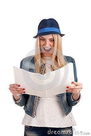 Shocked lady reading womens magazine