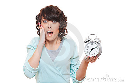 Portrait of shocked woman with alarm clock