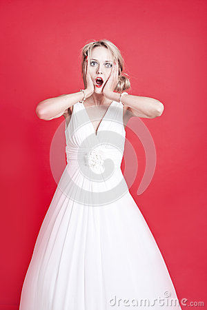 Portrait of shocked young Caucasian woman