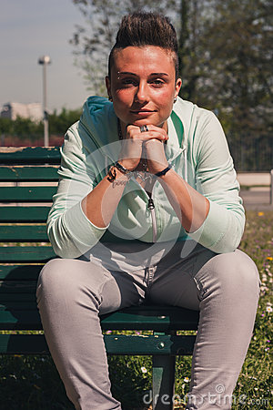 Portrait of a short hair girl sitting on bench Stock Photo