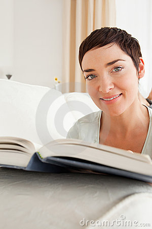 Portrait of a short-haired woman with a book