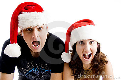 Portrait of shouting couple wearing christmas hat