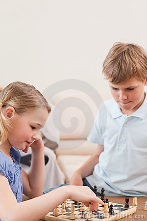 Portrait of siblings playing chess