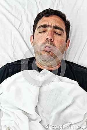 Portrait of a sick hispanic man coughing