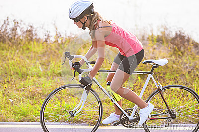 Portrait of a single female athlete on bike exercising