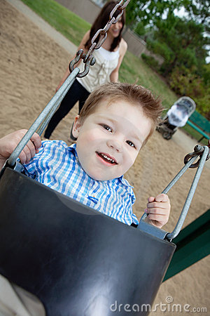 Portrait of Small Boy Swinging