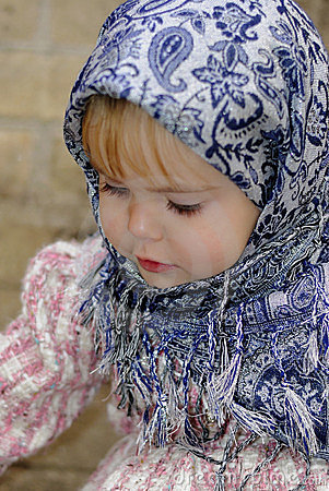 Portrait of the small girl in a blue scarf