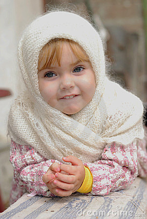 Portrait of the small girl in the scarf
