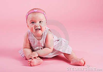 Portrait of the small joyful girl