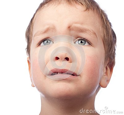 Portrait of small sad boy