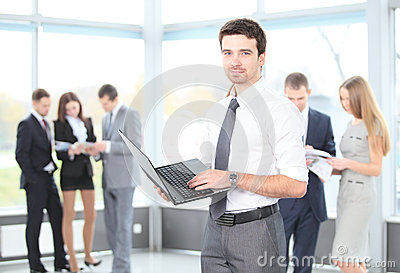 Portrait of a smart business man using laptop