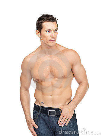 Portrait of smart young muscular man posing