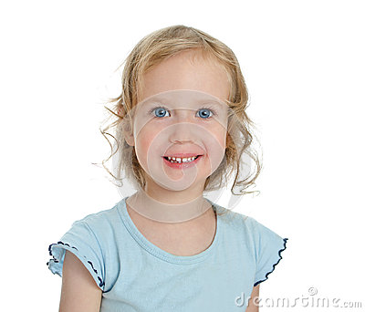 Portrait of smiling beautiful blond little girl.