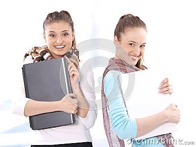 Portrait of smiling beautiful female students