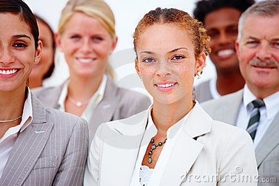 Portrait of smiling business people against white