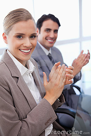 Portrait of a smiling business team applauding