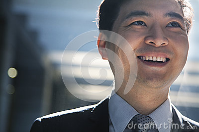 Portrait of smiling businessman in a parking garage