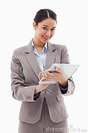 Portrait of a smiling businesswoman using a tablet computer