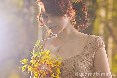 Portrait of smiling caucasian girl with flowers
