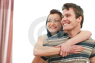 Portrait of smiling couple looking on copyspace