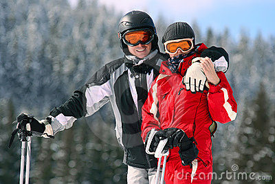 Portrait of smiling couple on skis