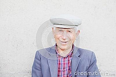 Portrait of smiling elederly man in cap