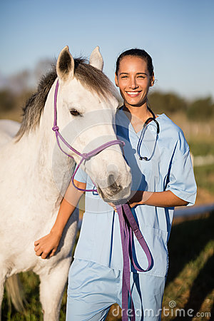 Free Portrait Smiling Female Vet By Horse Royalty Free Stock Photography - 97407407