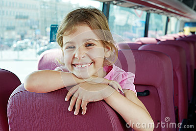 Portrait of smiling girl on bus seat