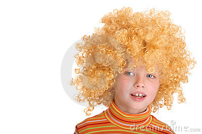 Portrait of smiling girl in curly wig.