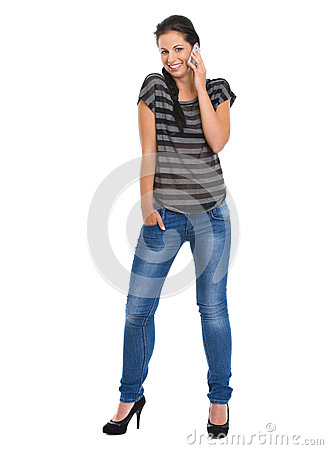 Portrait of smiling girl speaking mobile phone