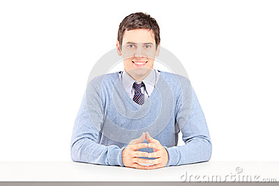 A portrait of smiling guy sitting during an interview