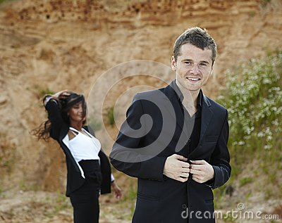 Portrait of smiling handsome businessman outdoor.