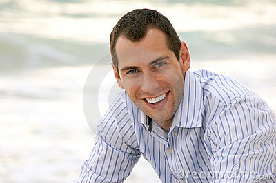Portrait of smiling handsome man looking at viewer