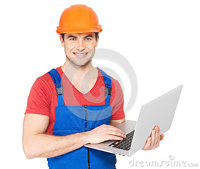 Handyman with laptop isolated on  white