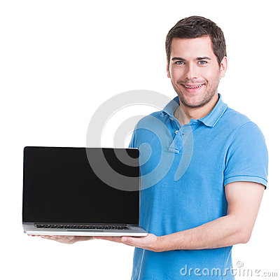 Portrait of smiling happy man holds laptop.