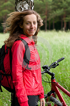 Portrait of smiling happy woman cyclist