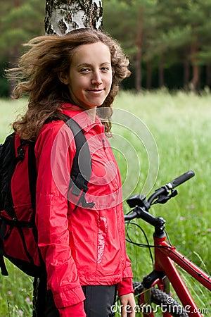 Portrait of smiling happy woman cyclist