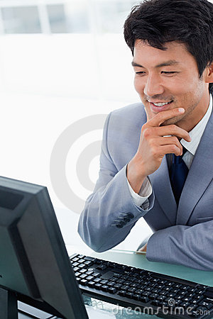 Portrait of a smiling manager using a computer