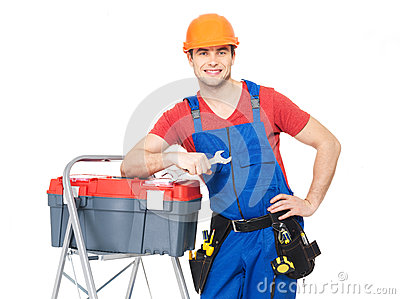 Smiling manual worker with tools