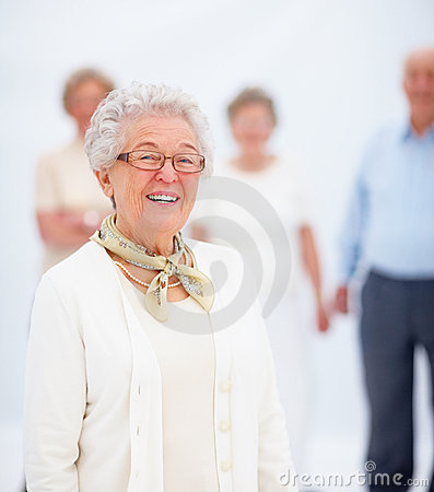 Portrait of a smiling mature lady with friends