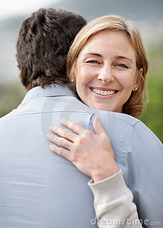 Portrait of smiling mature woman hugging a man